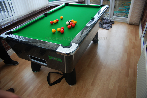 Black Marble Winner pool table with Green Smart cloth